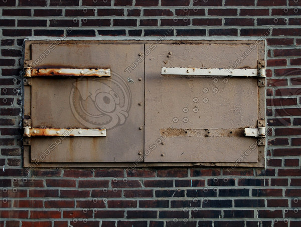 Rusty Hatch Door on Brick