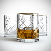 Crystal glass of whiskey with ice
