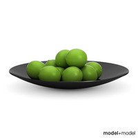 Limes in a black metal bowl