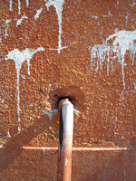 grunge wall fragment with a pipe