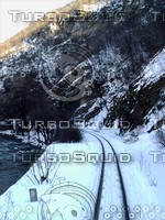 Mountain railway and road ( turn in shadow )