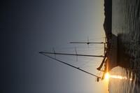 boat ocean sun
