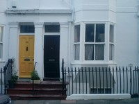 british townhouse black door yellow