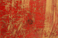 Red painted scratched wood board background