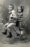 Old postcard, Boy Girl and tricycle