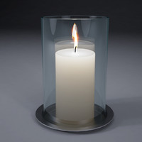 White candles in glass jar