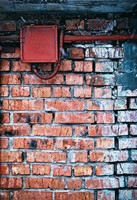 Grungy urban background of a brick wall with electric box