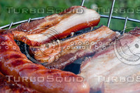 Sausages and bacon on the grill